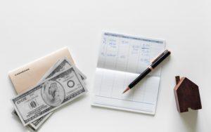 money, pen on table top, appraisal cost